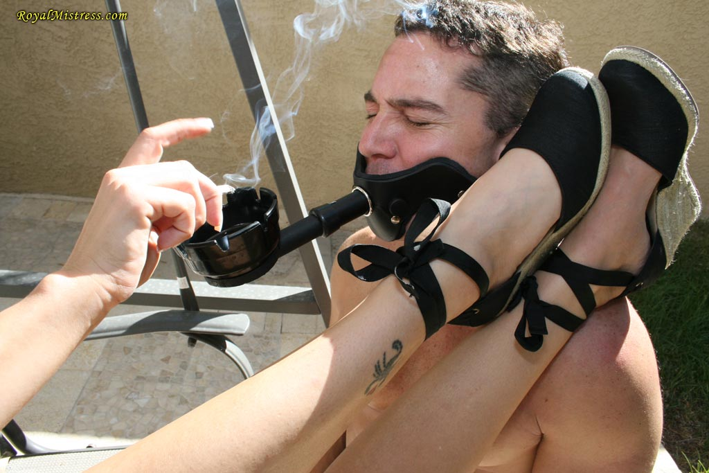 Mistress shoves her toes into slave mouth