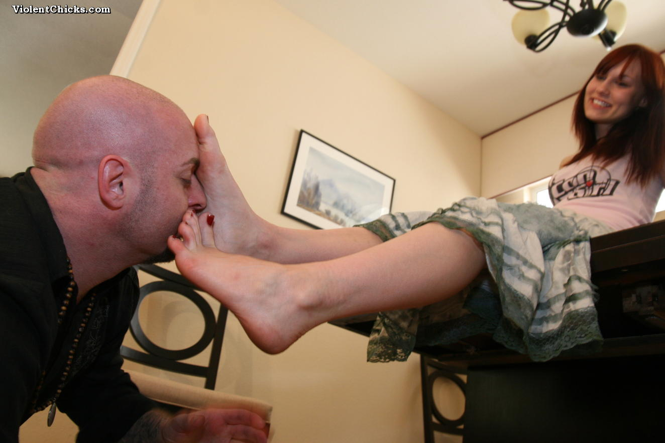 Mistress forces slave to worship her feet